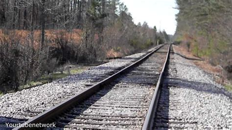 Ghost waiting for a train on an abandoned railroad track