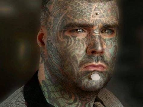 Body Art: UK's most tattoed man who dyed his eyes calls