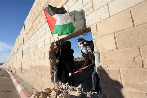 Palestinian Youths Break Through Israeli Partition on