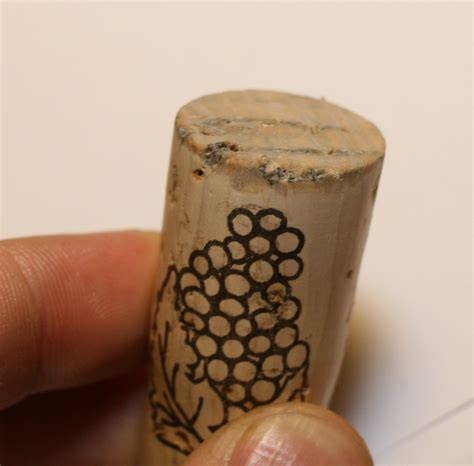 """wine - Is it okay for cork to look a bit """"moldy"""
