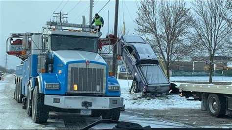 Car skids off icy Minnesota road and onto guy-wire